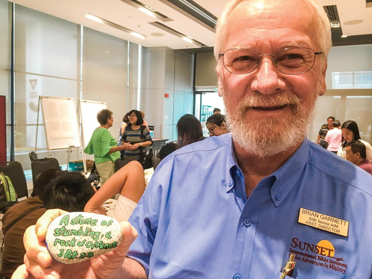 Brian Garnett with a painted rock from a retreat activity
