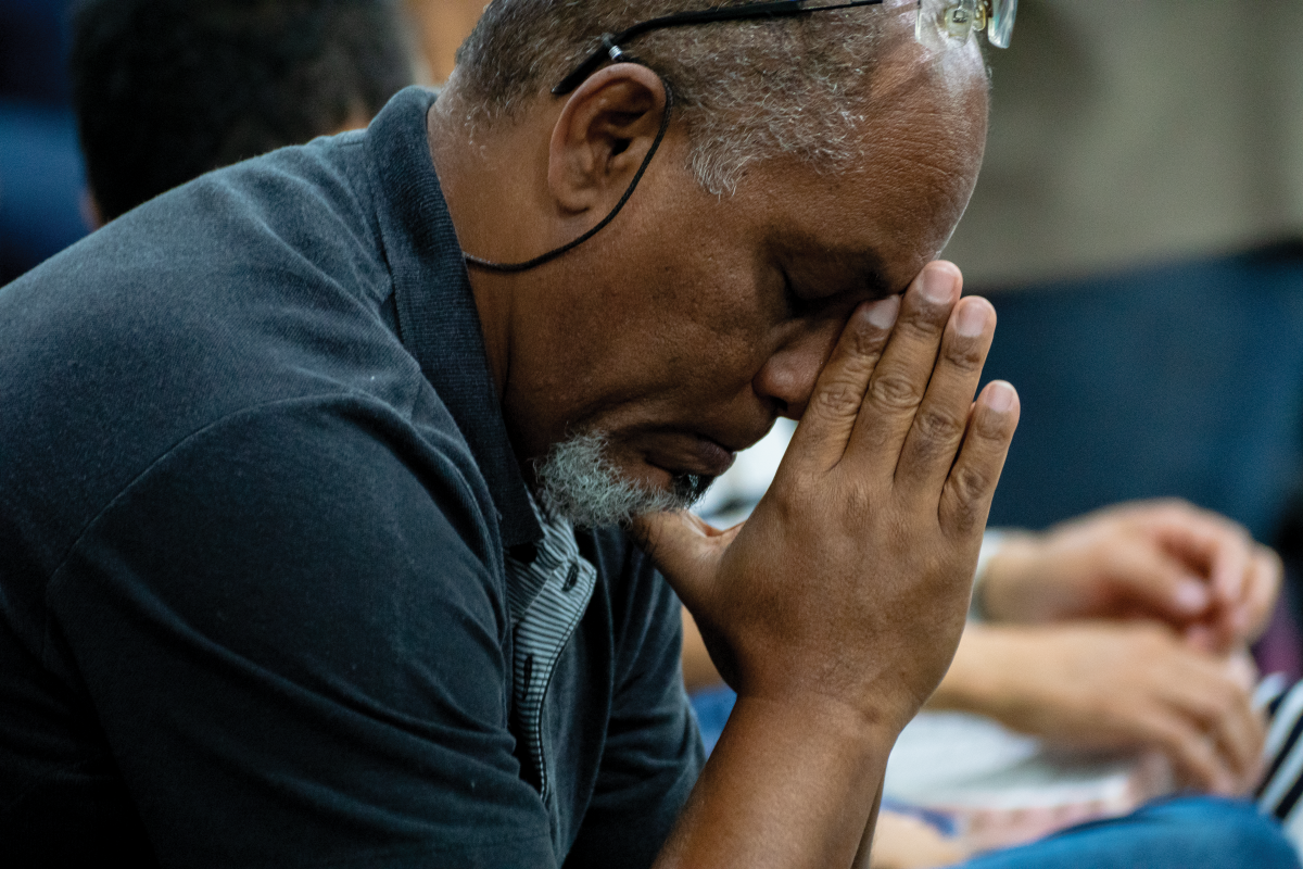 A brother in Brazil prays during communion