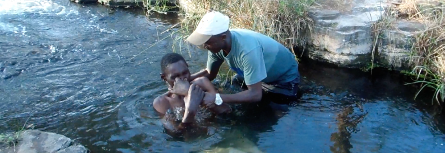 Geoffrey baptizing after much study