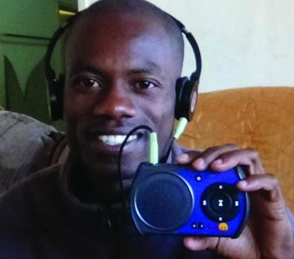 A young preacher in Zimbabwe excited to receive his solar-powered audio player